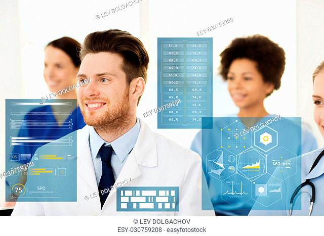 medicine, healthcare, technology and people concept - happy male doctor over group of medics meeting at hospital