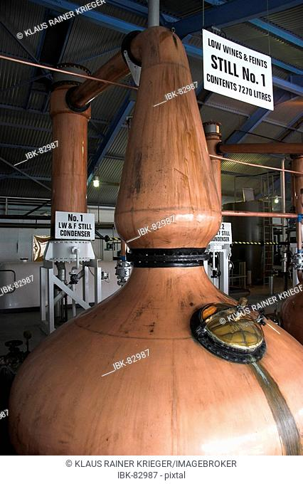 The stills of Laphroaig distillery with her typical small necks. Isle of Islay, Scotland