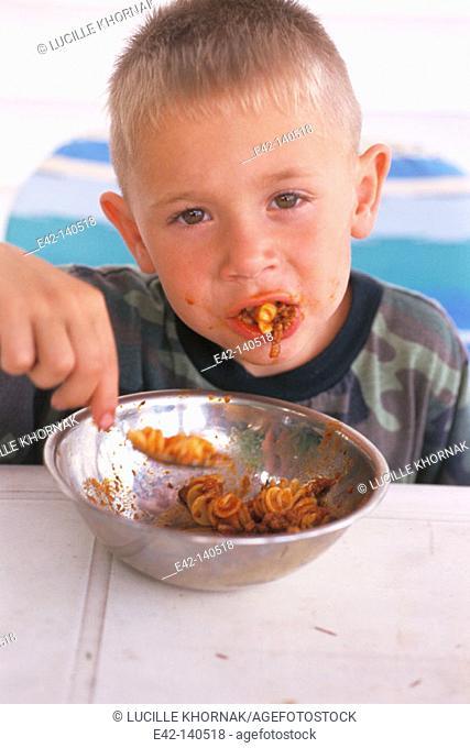 Boy eating italian food