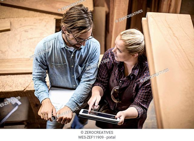 Man and woman working together in woodwork