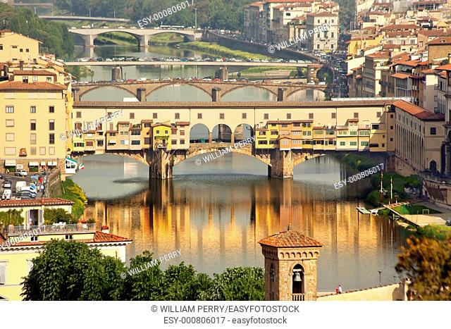 Ponte Vecchio Covered Bridge Arno River Reflection Florence Italy Bridge is the oldest bridge in Florence built in 1345 by Neri di Fioravante from Michelangelo...