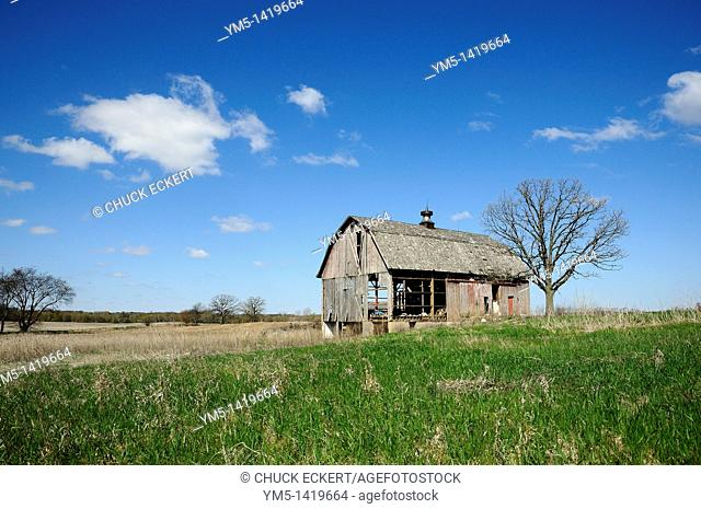 Abandoned run down barn on farm landscape