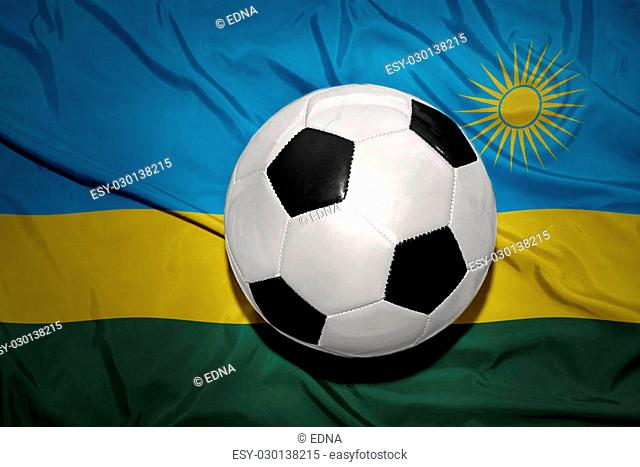 vintage black and white football ball on the national flag of rwanda