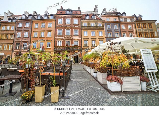 Street cafe in Warsaw placed on rynek Starego Miasta in old town. Image is taken on 06/11/2015