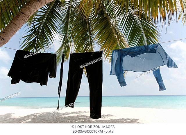 Business clothes drying on line on beach