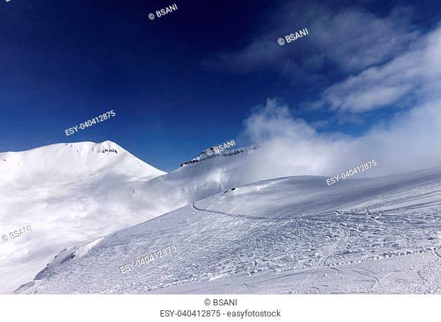 Off-piste slope with traces of skis. Georgia, ski resort Gudauri. Caucasus Mountains