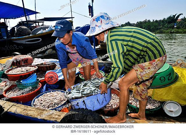 Women disembarking fishing boat, Hoi An, Vietnam, Southeast Asia