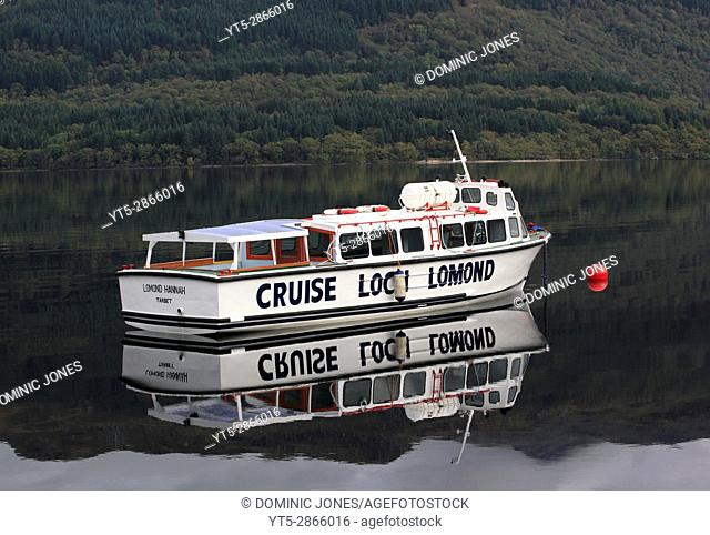 A moored tour cruise boat on Loch Lommond, Trossachs National Park, Scotland, Europe