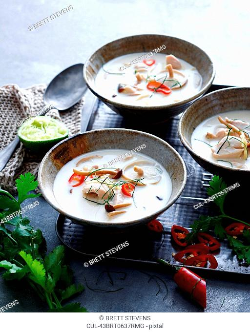 Bowls of fish and vegetable soup