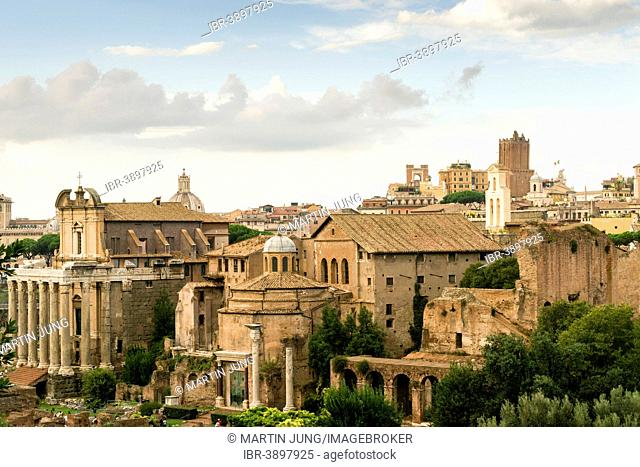 Temple of Antoninus and Faustina on the left, 141 AD, Romulus Temple, the Basilica of Maxentius, Torre delle Milizie tower at the back, Roman Forum, Rome, Lazio