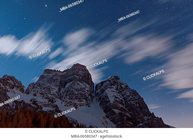 Night view towards Mount pelmo from refuge Città di Fiume in winter time, Dolomites, Veneto, Italy