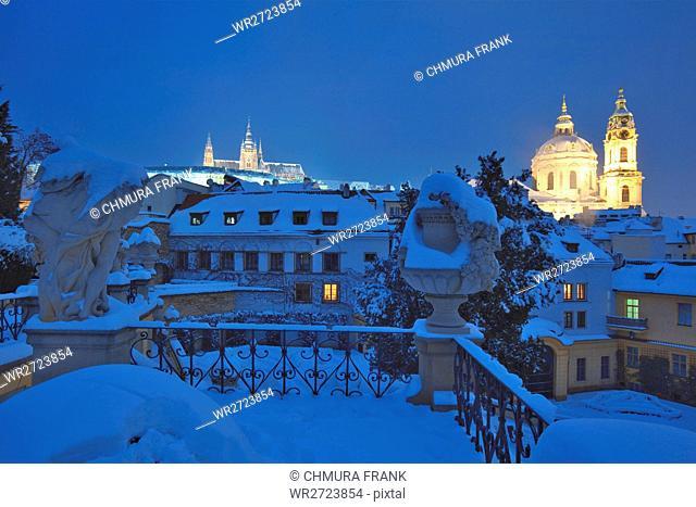 czech republic, prague - vrtba garden (vrtbovska zahrada), hradcany castle and st. nicholas church in winter