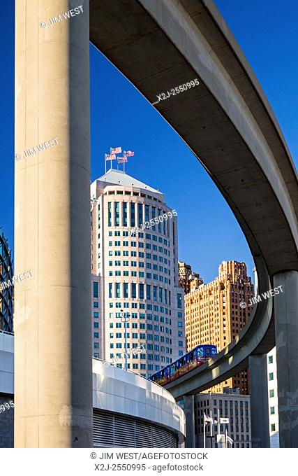 Detroit, Michigan - A downtown office building, 150 West Jefferson, is framed by the tracks of the Detroit People Mover