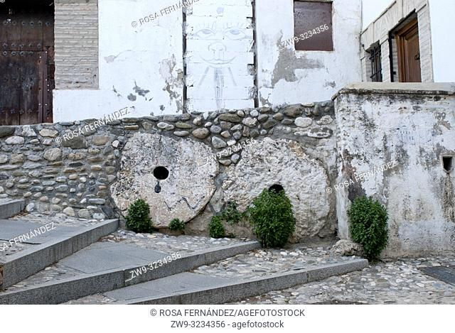 Tipical alley at the Albaicin quarter and a wall constructed with millstones, city of Granada, province of Granada, Spain, Europe