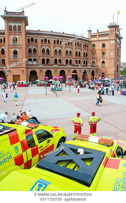 Cleaning vans and Las Ventas bullring during San Isidro festival. Madrid, Spain