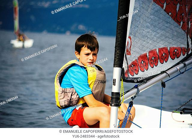 Children during a sailing course on Lake Maggiore, Ispra, Varese, Lombardy, Italy