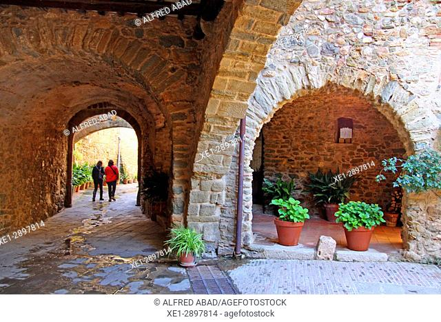 Cobbled street with arcades, Monells, Girona, Catalonia, Spain