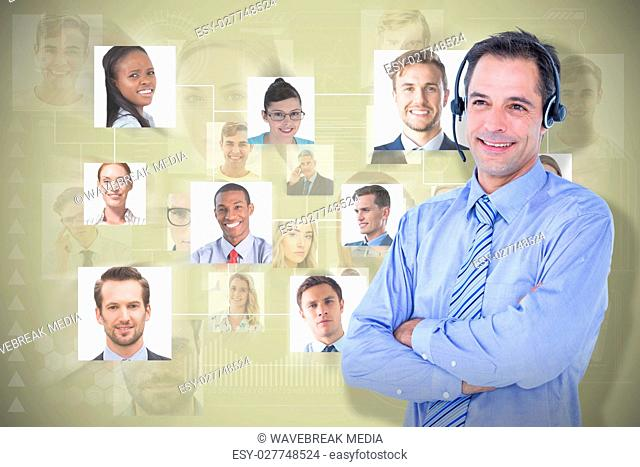Composite image of smiling businessman using headset