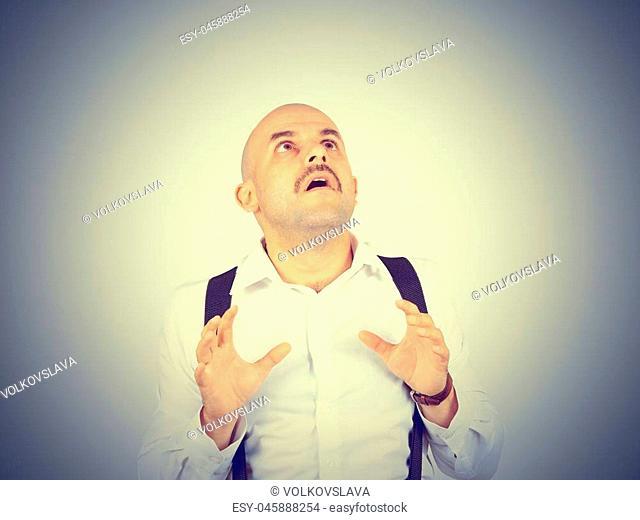 bald man feels awkward, anxiously isolated. fear phobia