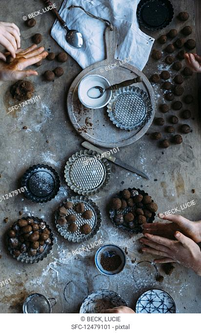Fresh gingerbread nuts (pepernoten in Dutch) the making off with hands on a table
