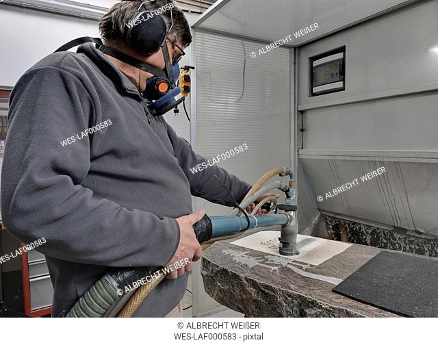 Germany, Stone mason manufacturing grave stone