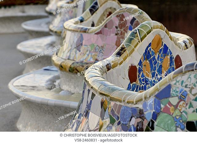 "Spain, Catalonia, Barcelona, World Heritage Site, Park Guell, Serpentine bench decorated with """"Trencadis"""" (Earthenware mosaics)"