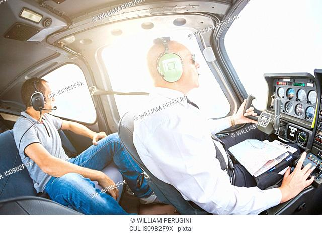 Pilot and passenger in small aircraft