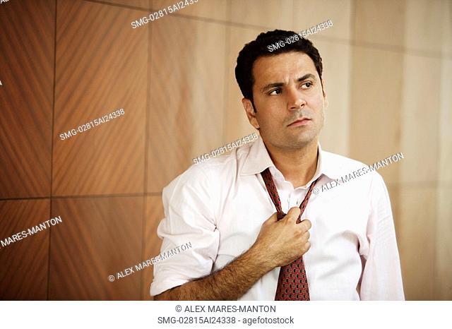 businessman loosening tie