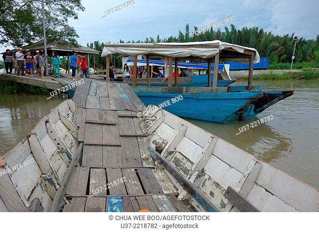 Ferrying passengers across the river at Beliong, Sarawak, Malaysia