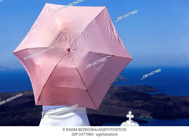 Woman with pink umbrella, Terrace, Santorini, Cyclades Islands, Greece, Europe