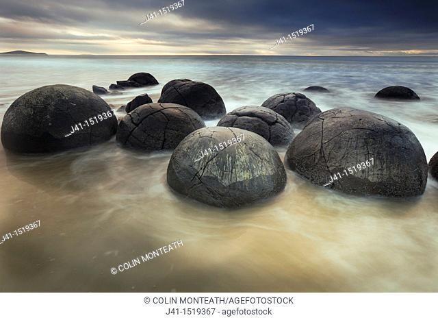 Moeraki boulders, sombre winter dawn, near Oamaru, Otago, South Island, New Zealand