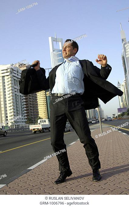 Jubilating businessman on Shaikh Zayed Road in Dubai