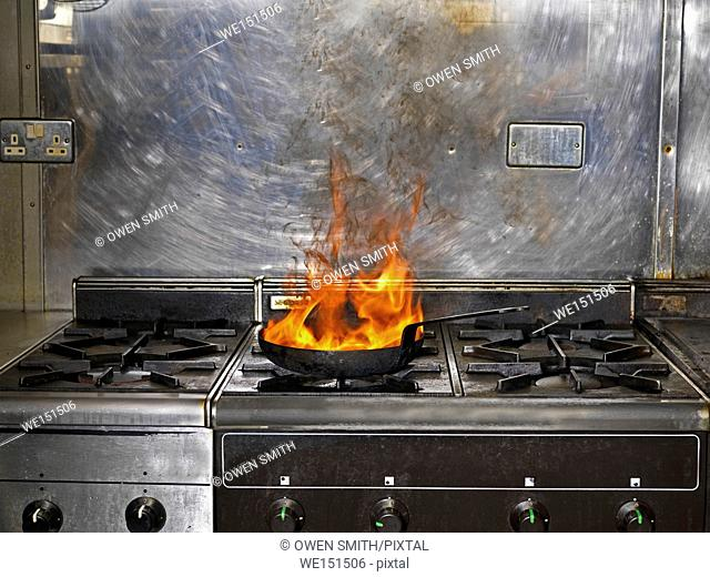 Frying Pan on Fire in restaurant kitchen
