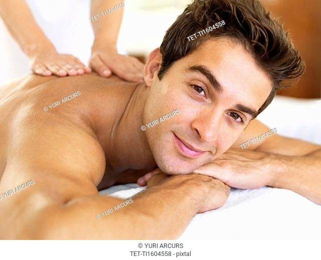 Man receiving massage in spa