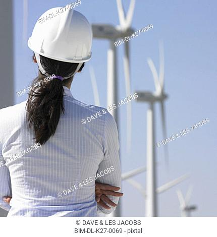 Female engineer examining wind turbines