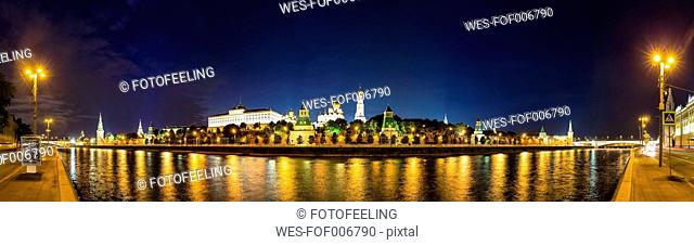 Russia, Moscow, Moskva River and Kremlin wall with towers at night