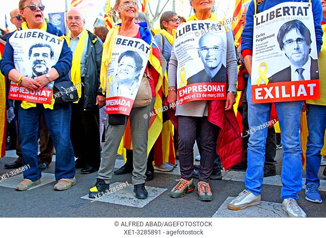 posters with political prisoners and exiles, Catalan pro-independence demonstration of March 16, 2019, Madrid, Spain