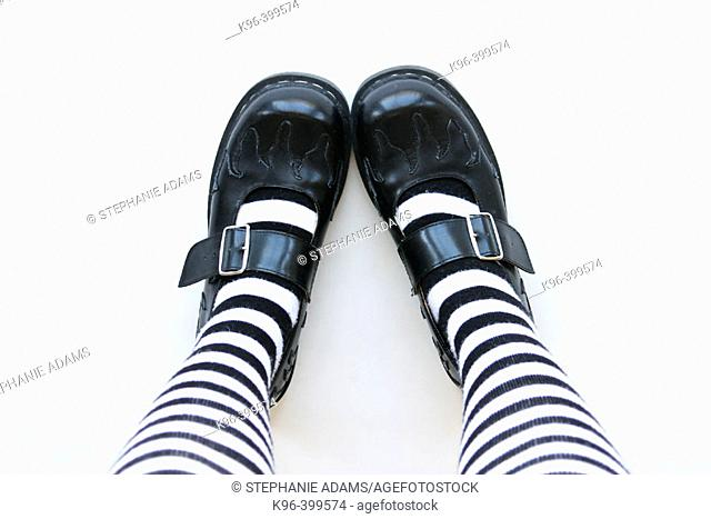 striped socks and black shoes
