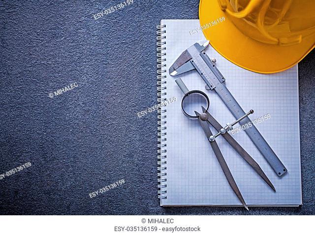 Notebook building helmet drawing compass slide caliper construction concept