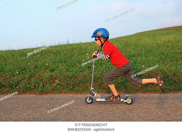 little boy on a kickboard, Switzerland
