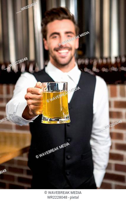 Barman holding a pint