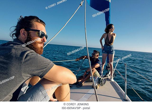 Friends enjoying view on sailboat, San Diego Bay, California, USA
