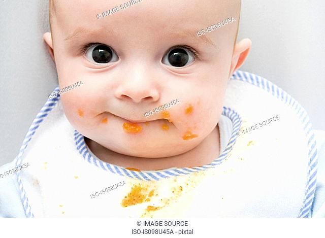 Baby with food on his face