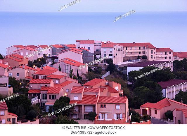 France, Languedoc-Roussillon, Pyrennes-Orientales Department, Vermillion Coast Area, Port-Vendres, hillside houses, dawn
