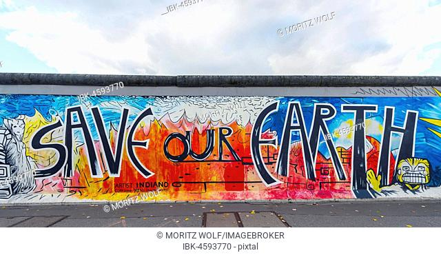 Lettering Save our Earth, artist Yvonne Matzat, painting of the Berlin Wall, East Side Gallery, Berlin, Germany