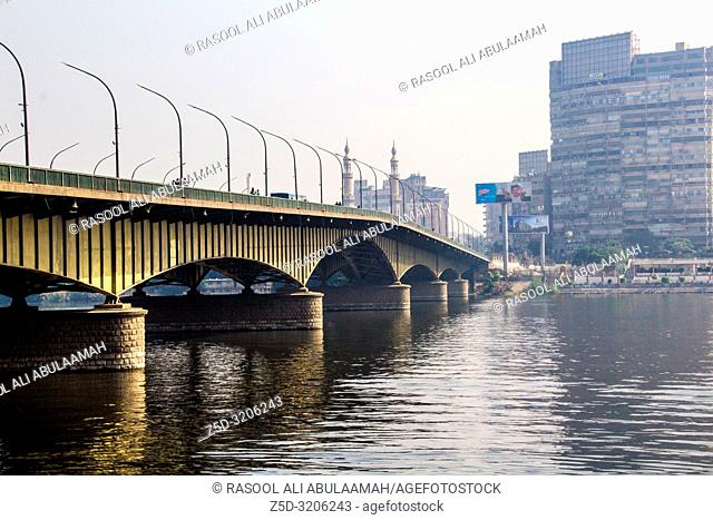 Cairo , Egypt – November 8, 2018: photo for University Bridge on Nile river in Cairo city capital of Egypt , it shows some tall buildings and a bridge