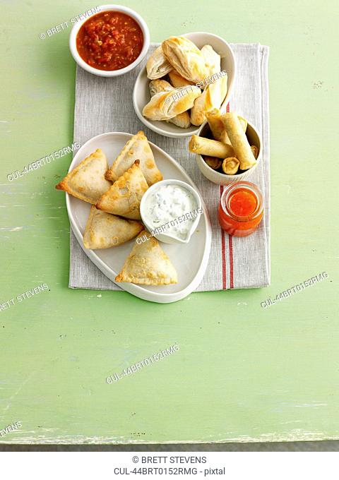 Plate of baked pastries with sauce