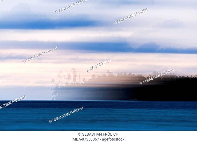 Intentional blurred island with palm trees, Banyak Island, Indonesia