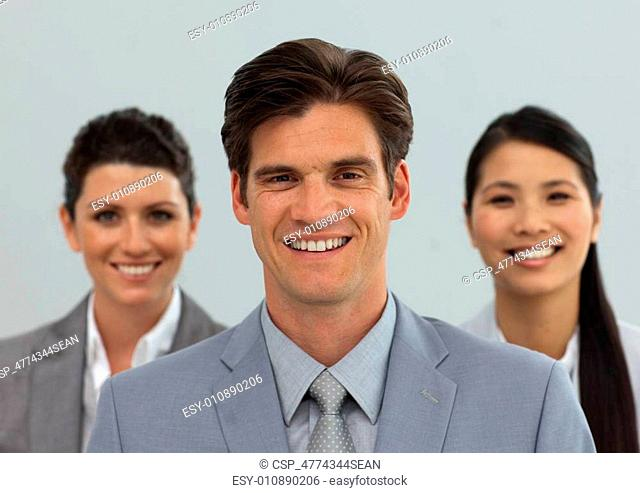 Diverse business people standing in a line smiling at the camera