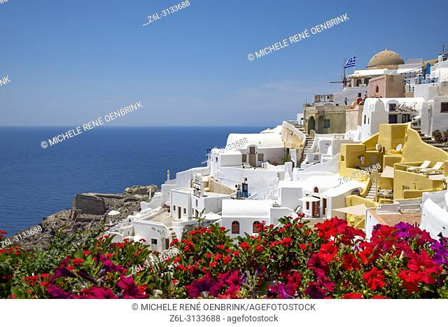 Scenic overlook of Oia Santorini Greece with flowers